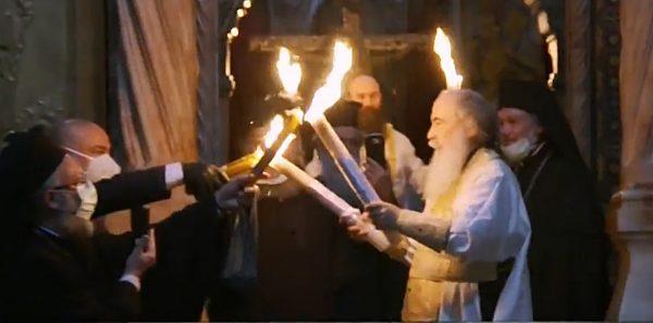 Pace în lume! Sfânta lumină a fost primită la Ierusalim (VIDEO)
